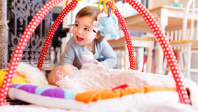 Toddler girl playing with her newborn sister Royalty Free Stock Images