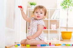 Toddler girl playing with her toy blocks Royalty Free Stock Photography