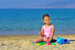 Toddler girl playing with her toys at beach Royalty Free Stock Photo