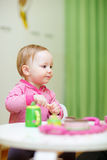Toddler girl playing at home Royalty Free Stock Images