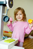 Toddler girl playing kitchen Royalty Free Stock Photo