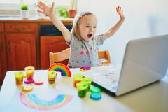 Free Toddler Girl Playing Modelling Clay In Front Of Laptop Stock Photo - 218198040