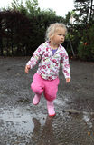 Toddler girl playing outdoors Royalty Free Stock Images