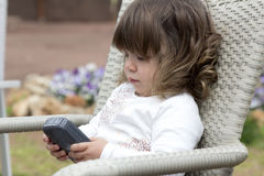 Toddler girl playing with phone Royalty Free Stock Images