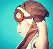 Toddler girl playing in pilot glasses Royalty Free Stock Image