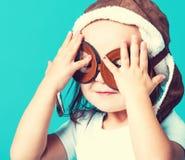 Toddler girl playing in pilot glasses Royalty Free Stock Photos