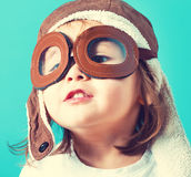 Toddler girl playing in pilot glasses Royalty Free Stock Images