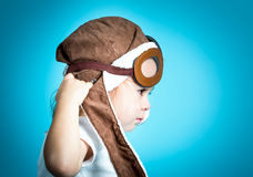 Toddler girl playing in pilot glasses Stock Photography