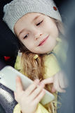 Toddler girl is playing smartphone Stock Photo