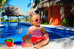 Toddler girl playing in swimming pool at beach Stock Images