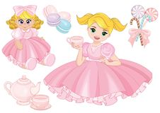 Toddler girl playing tea party with a doll Royalty Free Stock Photo