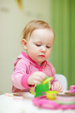 Toddler girl playing with toys Royalty Free Stock Image