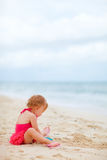 Toddler girl playing with toys at beach Royalty Free Stock Photo