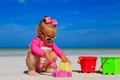Toddler girl playing with toys on tropical beach Stock Photography