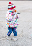 Toddler girl playing on a walk Royalty Free Stock Image