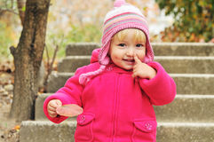 Toddler girl pointing her nose Stock Images