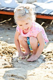 Toddler girl and puddle Royalty Free Stock Images