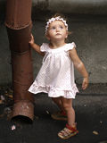 Toddler girl and rainwater pipe Royalty Free Stock Photos