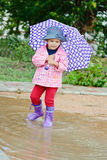 Toddler girl at rainy day i Royalty Free Stock Photos