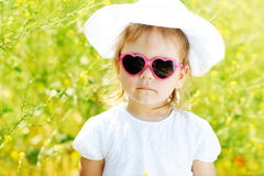 Toddler girl  in rape field Royalty Free Stock Photography