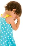 Toddler girl rubbing eyes Stock Photo