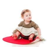 Toddler girl sitting Stock Photography