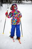 Toddler girl skiing on a bright winter day Stock Images