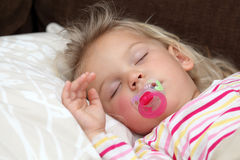 Toddler girl sleeping Stock Images