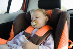 Toddler girl sleeping in baby car seat Stock Photos