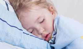 Toddler girl is sleeping. Covered with a blanket Royalty Free Stock Images
