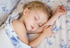Toddler girl is sleeping. Covered with a blanket Royalty Free Stock Photos