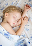 Toddler girl is sleeping. Covered with a blanket Royalty Free Stock Image
