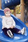 Toddler girl on slider Stock Photos