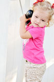 Toddler girl speaking on the phone Stock Images