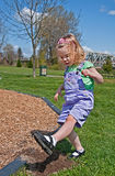 Toddler Girl is Stomping Dirt Stock Photos