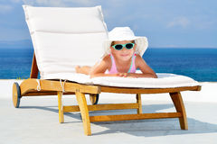Toddler girl on sunbed Royalty Free Stock Photo