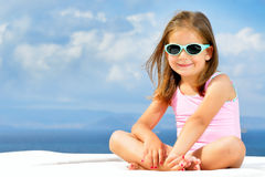Toddler girl on sunbed. Adorable toddler girl relaxing on sunbed Royalty Free Stock Photos