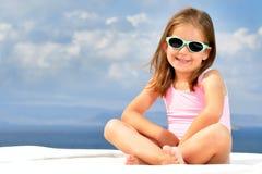 Toddler girl on sunbed. Toddler girl relaxing on sunbed Stock Image