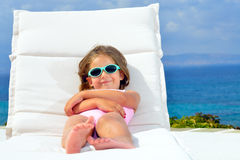 Toddler girl on sunbed Stock Photography