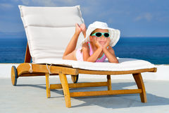 Toddler girl on sunbed Stock Image