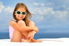 Toddler girl on sunbed. Todler girl relaxing on sunbed Stock Images
