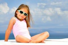 Toddler girl on sunbed Stock Photo