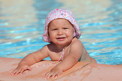 Toddler girl in a swimming pool Stock Image