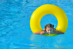 Toddler girl in swimming pool Royalty Free Stock Photography