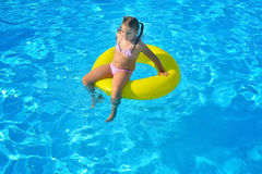 Toddler girl in swimming pool Stock Photography
