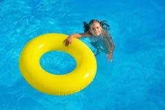Toddler girl in swimming pool Royalty Free Stock Photos
