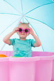 Toddler girl in swimming pool Stock Images