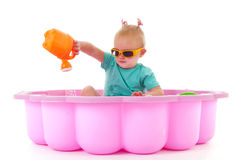 Toddler girl in swimming pool. Toddler girl playing in swimming pool isolated over white background stock images