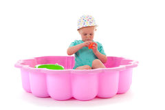Toddler girl in swimming pool. Toddler girl playing in swimming pool isolated over white background royalty free stock photos
