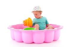 Toddler girl in swimming pool Stock Photos